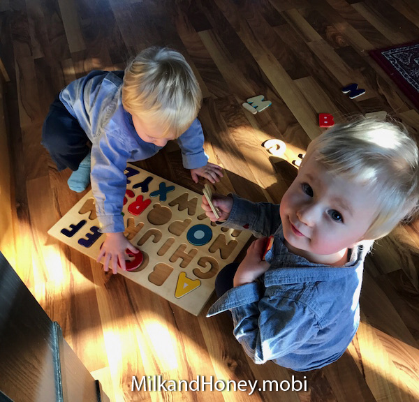 The twins working on their favorite puzzle!